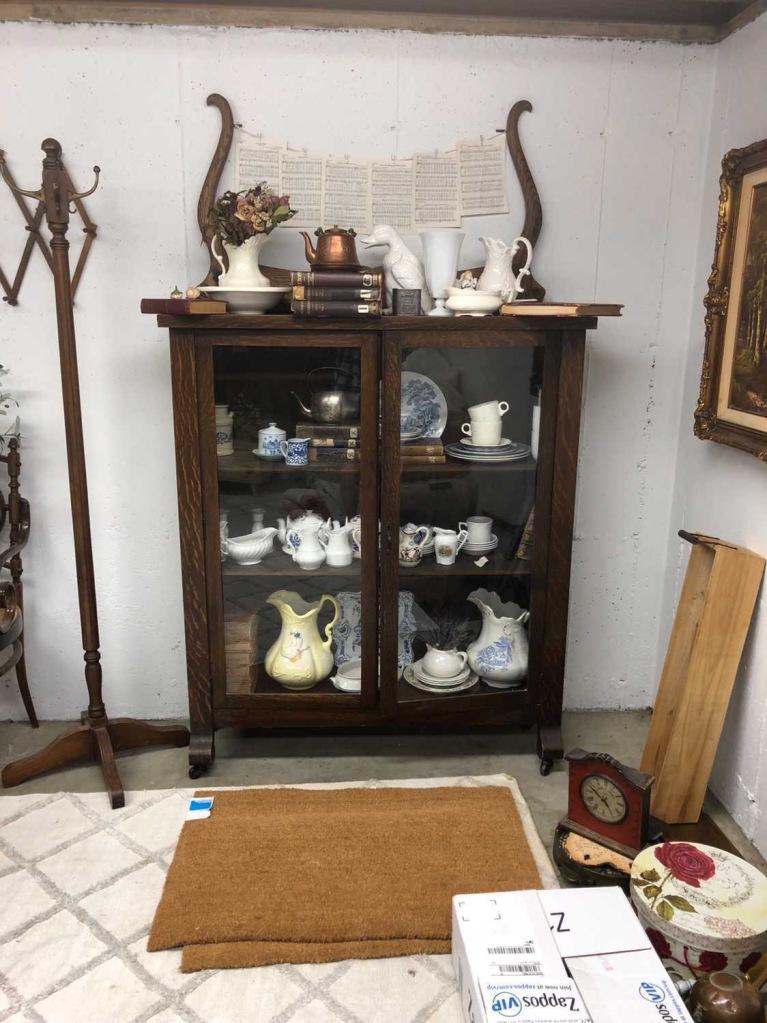 Messy basement corner piled with vintage finds