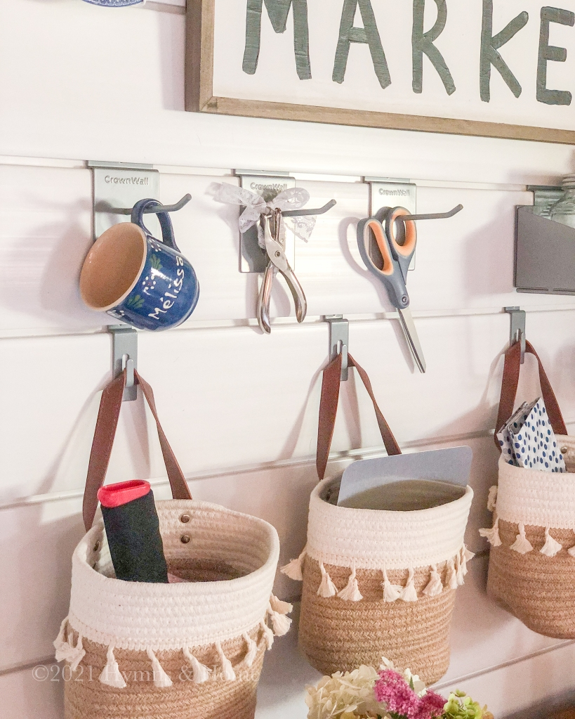 Pretty hanging storage baskets lined up with tools ready to use.