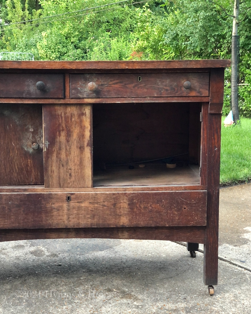 Dirty, chipping, old vintage wooden cabinet with missing door and missing drawer knob.