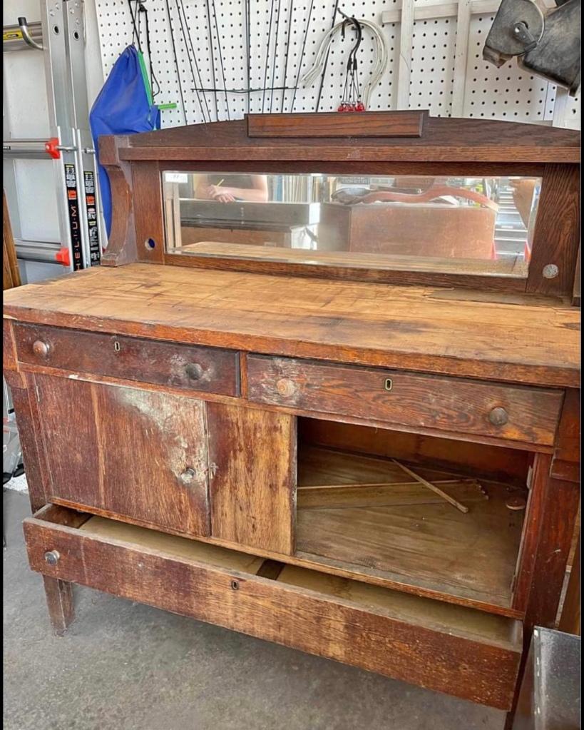 old beat up vintage wooden sideboard