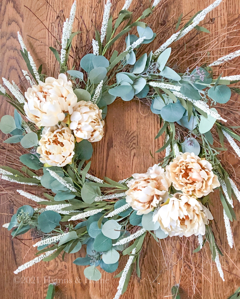 Fall wreath with eucalyptus, foxtails, and cream colored peonies